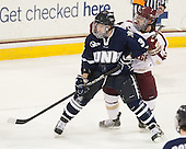 Austin Block (UNH - 3), Steven Whitney (BC - 21) - The Boston College Eagles and University of New Hampshire Wildcats tied 4-4 on Sunday, February 17, 2013, at Kelley Rink in Conte Forum in Chestnut Hill, Massachusetts.