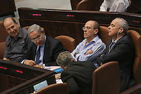 "Minister of Energy and Water Silvan Shalom (C) rests as he sits next to Israel's Prime Minister Benjamin Netanyahu (2L) Defense Minister Moshe (""Boogie"") Yaalon (L)  during a plenum session voting on the state budget, in the Knesset, Israel's Parliament, in Jerusalem, late night July 29, 2013. The Knesset approved the State Budget at second and third readings in the early hours of Tuesday morning in a 58-43 vote, following a 15-hour parliamentary session. Photo by Oren Nahshon"