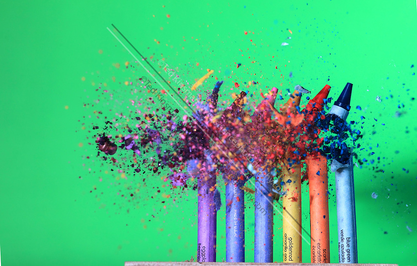 A .22 caliber bullet hitting crayons. The bullet is travelling at 660 feet per second (201 meters per second). This image shows the collision of the bullet and crayons photographed at at 1/1,000,000th of a second flash/strobe speed.