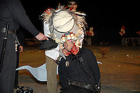 "Ben Fain's ""Gemini Brine"" performance at the Masquerade Parking Lot in Atlanta, Georgia. In his performance art production about abuse of power and idol worship he appeared as a fish dressed in doctor's garb."