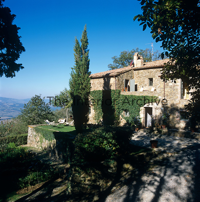 This converted stone farm building is situated on a hill with views over the Tuscan landscape