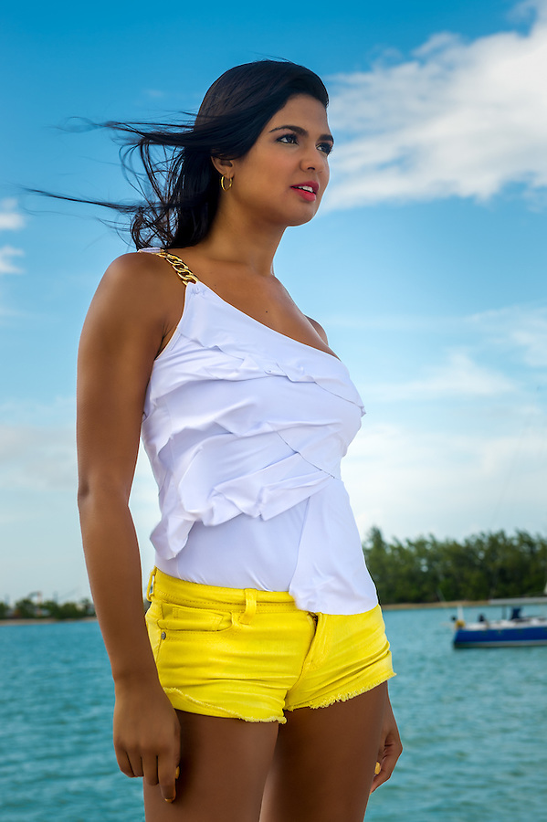 Beautiful hot female in summer standing over the beach background