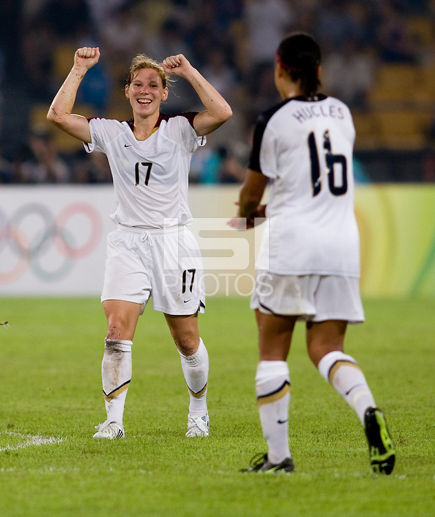 USWNT defender (17) celebrates the win with teammate (16) Angela Hucles after playing at Worker's Stadium.  The USWNT defeated Japan, 4-2, during the semi-finals of the Beijing 2008 Olympics in Beijing, China.