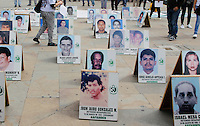 Pictures of people missing by armed conflict are seen in a square, commemorating the International Day of the people disappeared on August 30, 2016. in Medellin, Colombia. Photo by VIEWpress