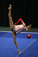 Brenann Stacker of USA (shot from balcony above), performs intricate handling with ball at San Francisco Invitational on February 11, 2006. Stacker placed 3rd in All-Around competition.  (Photo by Tom Theobald)