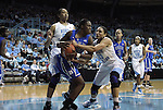 26 February 2012: Duke's Chelsea Gray (12) is challenged for the ball by North Carolina's Krista Gross (21) and Chay Shegog (left). The Duke University Blue Devils defeated the University of North Carolina Tar Heels 69-63 at Carmichael Arena in Chapel Hill, North Carolina in an NCAA Division I Women's basketball game.