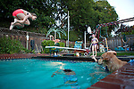 Children swim while gathered at a National Night Out neighborhood party Aug. 10.<br />