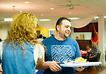 Waterbury, CT- 18 May 2017-051817CM06-  Geni Agolli and his wife, Ada get food during the Albanian Festival at the Albanian American Muslim Community center.  The event continues Friday from 5p.m. until 11p.m. and Saturday from 12 p.m. until 11 p.m.  Christopher Massa Republican-American