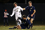 24 November 2013: Wake Forest's Luca Gimenez (BRA) (11) is defended by Navy's Derek Vogel (below) and Zach Davis (14). The Wake Forest University Demon Deacons played the Naval Academy Midshipmen at Spry Stadium in Winston-Salem, NC in a 2013 NCAA Division I Men's Soccer Tournament Second Round match. Wake Forest won the game 2-1.