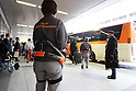 Tokyo airport workers use robot suits to help with heavy work
