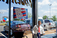 Vince Sheehy, owner of Sheehy Auto Stores, poses for a portrait at one of his dealerships on Friday, June 4, 2010 in Springfield, VA. CREDIT: Brendan Hoffman for The Wall Street JournalFINREG
