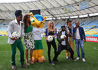 Artists Carlinhos Brown, Ivete Sangalo, Shakira, Wyclef Jean, Carlos Santana and Alexandre Pires pose on the Maracana pitch ahead of tomorrow's FIFA World Cup Final, Germany vs Argentina where they will perform at the closing ceremony