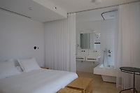 White sheer curtains cloak the bathroom in one of the bedrooms at the Hotel Aire de Bardenas