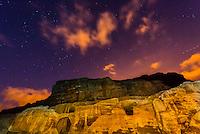 Caves at Petra Archaeological Park illuminated by flashlight at night, Jordan.
