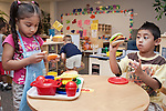 """September 14, 2011. Raleigh, NC. . Ashely Fuentes-Banegas and Jeffrey Hernandez-Valladares play at the """"restaurant"""".. Project Enlightenment, a public pre-kindergarten program for at risk children, has been threatened with closure due to state wide budget cuts.."""