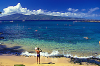 Kapalua Bay, one of Maui's best beaches, has breathtaking views of the island of Molokai, great snorkeling, swimming, sunbathing and wonderful sunsets. Island of Molokai is in the background.