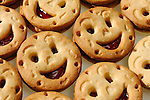 Smiling cookies filled with jam
