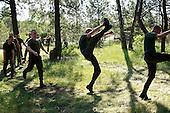 The last draft. Young Polish soldiers stretching up at the range. <br /> Rembertow, Poland, May 2008<br /> (Photo by Piotr Malecki / Napo Images)<br /> Ostatni pobor.Rozgrzewka na poligonie. Rembertow.5/2008<br /> Fot: Piotr Malecki / Napo Images