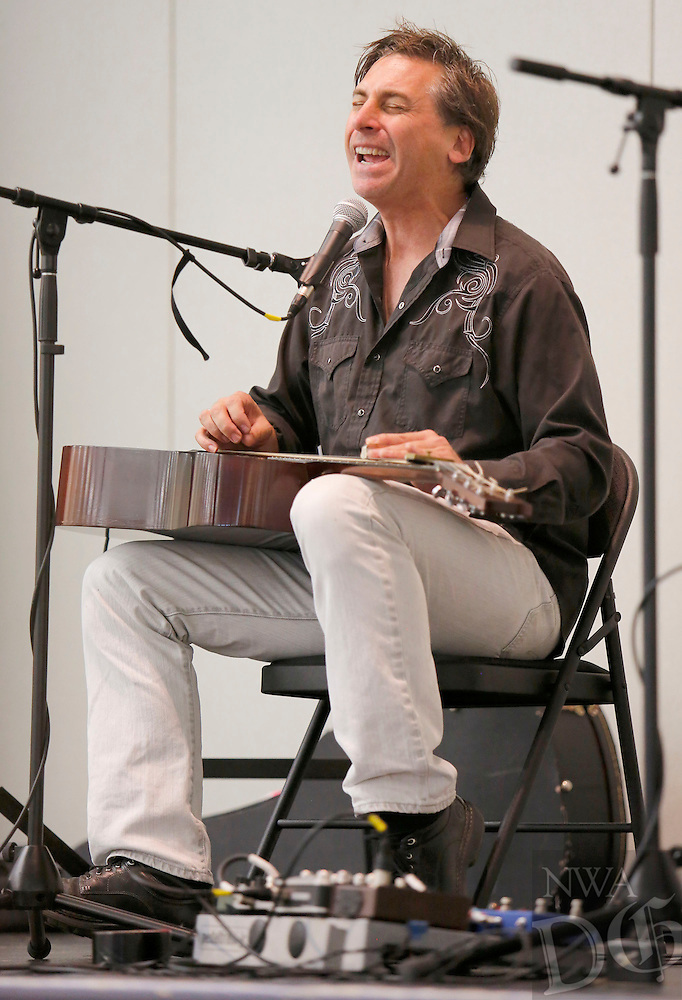 NWA Democrat-Gazette/DAVID GOTTSCHALK  Joe Crookston performs a blues song on stage Tuesday, October 6, 2015 on stage for the fifth grade students at Holt Middle School in Fayetteville. Crookston performed and led workshops in the area for the past week as part of the True Lit Festival.