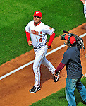13 April 2009: Washington Nationals' Manager Manny Acta is followed by a television cameraman as he trots to home plate prior to a game against the Philadelphia Phillies at the Nats' Home Opener at Nationals Park in Washington, DC. The Nats fell short in their 9th inning rally, losing 9-8, and marking their 7th consecutive loss of the 2009 season. Mandatory Credit: Ed Wolfstein Photo