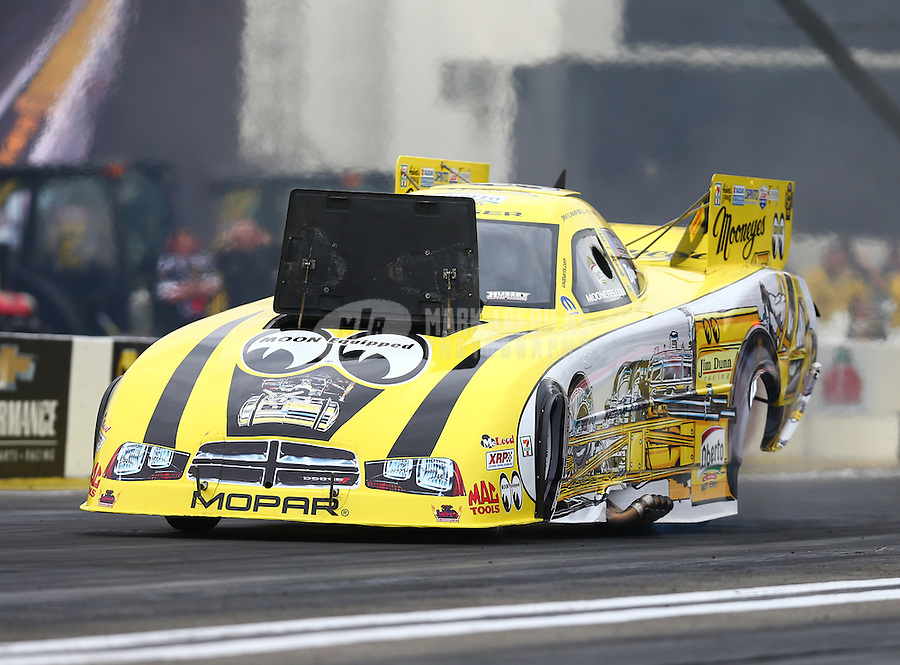 Feb 10, 2017; Pomona, CA, USA; Burst body panel pops up on the car of NHRA funny car driver Jim Campbell during qualifying for the Winternationals at Auto Club Raceway at Pomona. Mandatory Credit: Mark J. Rebilas-USA TODAY Sports