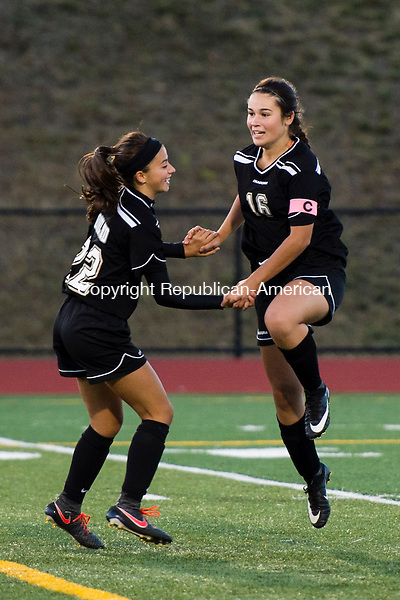 OXFORD, CT- 11 October 2016-101116EC21-  Woodland's Julia Accetura celebrates with Gillian Hotchkiss after Hotchkiss made a goal against Oxford Tuesday night. The Hawks won, 5-1. Erin Covey Republican-American