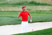 Bryson DeChambeau jumps in the bunker on the 1st fairway during the 2016 U.S. Open in Oakmont, Pennsylvania on June 16, 2016. (Photo by Jared Wickerham / DKPS)