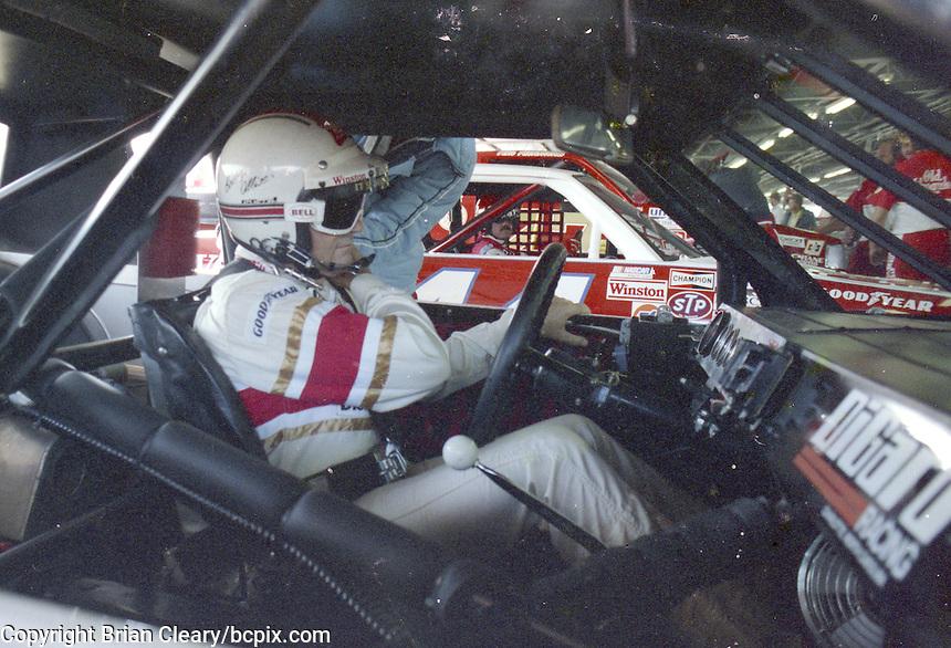 Race car driver Bobby Allison straps into his race car at  Atlanta International Raceway, Atlanta Journal 500, November 1983.  (Photo by Brian Cleary/www.bcpix.com)