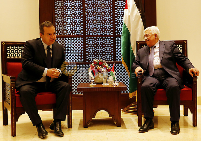 Palestinian president Mahmoud Abbas meets with Serbian Foreign Minister Ivica Dacic in the West Bank town of Bethlehem January 6, 2017. Photo by Wisam Hashlamoun