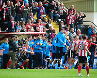 Lincoln City manager Danny Cowley is hugged by Lincoln City's assistant manager Nicky Cowley at the final whistle<br /> <br /> Photographer Chris Vaughan/CameraSport<br /> <br /> Vanarama National League - Lincoln City v Macclesfield Town - Saturday 22nd April 2017 - Sincil Bank - Lincoln<br /> <br /> World Copyright &copy; 2017 CameraSport. All rights reserved. 43 Linden Ave. Countesthorpe. Leicester. England. LE8 5PG - Tel: +44 (0) 116 277 4147 - admin@camerasport.com - www.camerasport.com