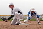 Nyssa's Rocky Garcia slides back into first base as Brady Sharp fields the pickoff throw during the second game of a doubleheader between Vale and Nyssa on April 15, 2011. One batter later, Garcia scored on Zach Stratton RBI double.It would be Nyssa's only run as they dropped the game 6-1.