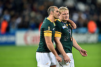 Ruan Pienaar of South Africa and team-mate Adriaan Strauss after the match. Rugby World Cup Bronze Final between South Africa and Argentina on October 30, 2015 at The Stadium, Queen Elizabeth Olympic Park in London, England. Photo by: Patrick Khachfe / Onside Images