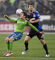 Seattle Sounders FC forward Mike Fucito, left, is thrown to the ground by San Jose Earthquakes defender Bobby Burling during play at CenturyLink Field in Seattle Saturday October 15, 2011. The Sounders FC won the game 2-1.