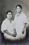 young Japanese women wearing kimono with apron begiinning of 1940s