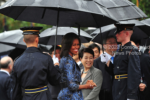 United States First Lady Michelle Obama (L) and South Korean First Lady Kim Yoon-ok attend an arrival ceremony for President Lee Myung-bak of South Korea on the South Lawn at the White House in Washington, D.C. on Thursday, October 13, 2011. .Credit: Kevin Dietsch / Pool via CNP