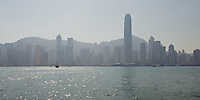 The Hong Kong island skyline, dominated by the 2IFC tower, seen from across the harbour in Tsim Sha Tsui, late afternoon