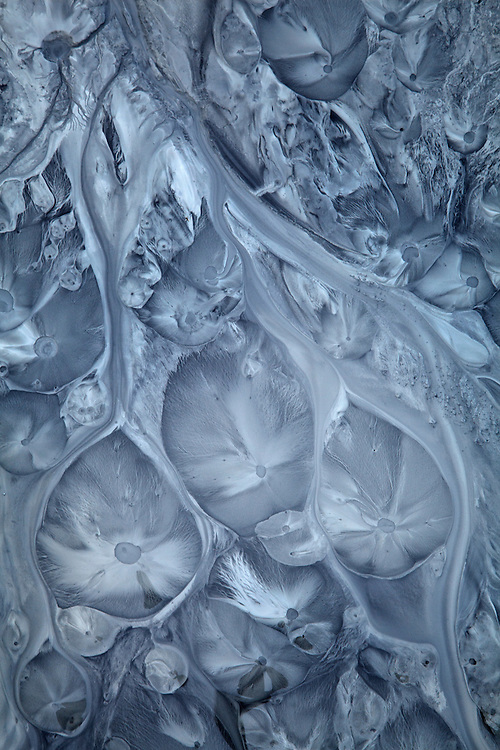 Ice patterns forms in the glacial silt at the Matanuska Glacier in Alaska, USA