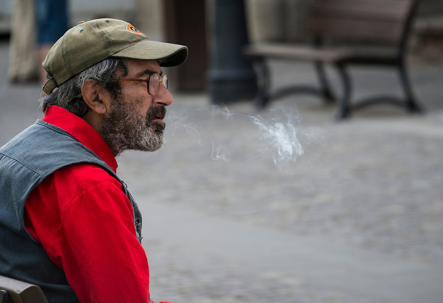 BUCHAREST, ROMANIA - September 30, 2012: Man smoking a cigarette in the streets of Bucharest