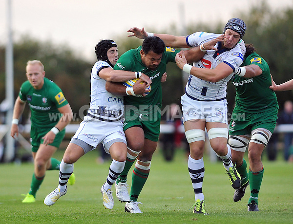Ofisa Treviranus takes on the Bristol defence. Pre-season friendly match, between London Irish and Bristol Rugby on August 22, 2014 at Hazelwood in Middlesex, England. Photo by: Patrick Khachfe / JMP
