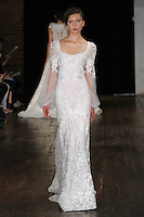 "Model walks runway in a ""Delight"" bridal gown from the Alyne by Rita Vinieris Fall 2017 collection on October 7th, 2016 during New York Bridal Fashion Week."