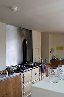 Although the house is thoroughly contemporary an old-fashioned Aga takes pride of place in the kitchen/dining area