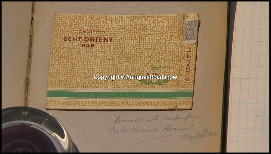 BNPS.co.uk (01202 558833)<br /> Pic: AntiquesRoadshow/BNPS<br /> <br /> ***Please Use Full Byline***<br /> <br /> The now empty packet of cigarettes that Field Marshall Rommel gave to Roy Wooldridge.<br /> Close ups of Roy's belongings that he took onto Antiques Roadshow. The episode will air this Sunday (23/11/14). <br /> <br /> The incredible story of how legendary German general Erwin Rommel spared the life of a captured British soldier and then served him a glass of beer has been revealed after 70 years.<br /> <br /> Captain Roy Wooldridge met Rommel after being taken prisoner in a dangerous night-time mission to examine submerged mines along the French beaches weeks before the D-Day landings.<br /> <br /> His story is to be told on BBC1's Antiques Roadshow this Sunday.