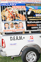 A pickup truck covered with pro-Trump and anti-Clinton and anti-United Nations posters and stickers stands parked outside a campaign rally for Democratic presidential nominee Hillary Clinton in the Theodore R. Gibson Health Center at Miami Dade College-Kendall Campus in Miami, Florida, USA. Former Vice President Al Gore also spoke at the rally.