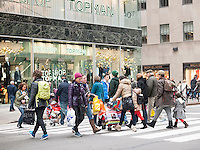 Pedestrians cross busy Fifth Avenue in New York on Sunday, November 16, 2014. (© Richard B. Levine)