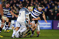 Henry Thomas of Bath Rugby takes on the Newcastle Falcons defence. Aviva Premiership match, between Bath Rugby and Newcastle Falcons on March 18, 2016 at the Recreation Ground in Bath, England. Photo by: Patrick Khachfe / Onside Images