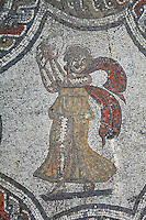 Dancer with a tambourine, from the Roman mosaic of the Four Seasons, in the dining room of the House of Dionysos, 3rd century AD, Volubilis, Northern Morocco. Volubilis was founded in the 3rd century BC by the Phoenicians and was a Roman settlement from the 1st century AD. Volubilis was a thriving Roman olive growing town until 280 AD and was settled until the 11th century. The buildings were largely destroyed by an earthquake in the 18th century and have since been excavated and partly restored. Volubilis was listed as a UNESCO World Heritage Site in 1997. Picture by Manuel Cohen