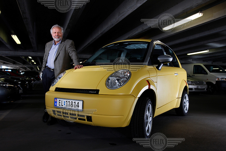 Think Global CEO Jan Olaf Willum with his company's TH!NK City electric car.