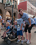 The Hegstrom's (L to R: Joslyn, Wyatt, Jamie) during the Main Street Mile in downtown Boise, Idaho on June 22, 2012.
