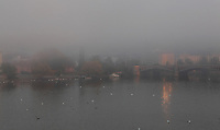 The Manes Bridge, built 1912-14, over the Vltava river, in the early morning mist, Prague, Czech Republic. This bridge connects the Ales Embankment with the Mala Strana or Lesser Quarter and is named after the Czech painter Josef Manes, 1820-71. The Manes Bridge was designed by Alois Novy, Frantisek Mencl and Mecislav Petru. It is 186m long and 16m wide and has 4 segmental arches. The historic centre of Prague was declared a UNESCO World Heritage Site in 1992. Picture by Manuel Cohen