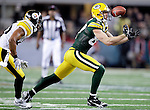 Green Bay Packers' Jordy Nelson can't hang on to a Aaron Rodgers pass in the 4th quarter. 1.The Green Bay Packers played the Pittsburgh Steelers in Super Bowl XLV,  Sunday February 6, 2011 in Cowboys Stadium. Steve Apps-State Journal.